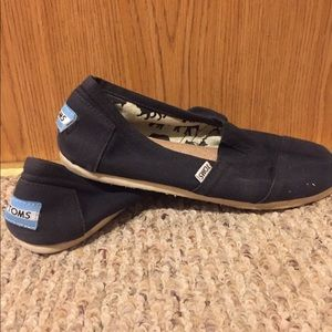 Toms never really worn because they were too big
